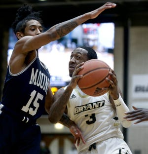 Bryant's Michael Green III drives to the hoop against Mount St. Mary's Damian Chong Qui during last week's Northeast Conference title game. Mount won and earned an automatic berth in the NCAA Tournament. Bryant on Monday accepted a bid to take part in the CBI.