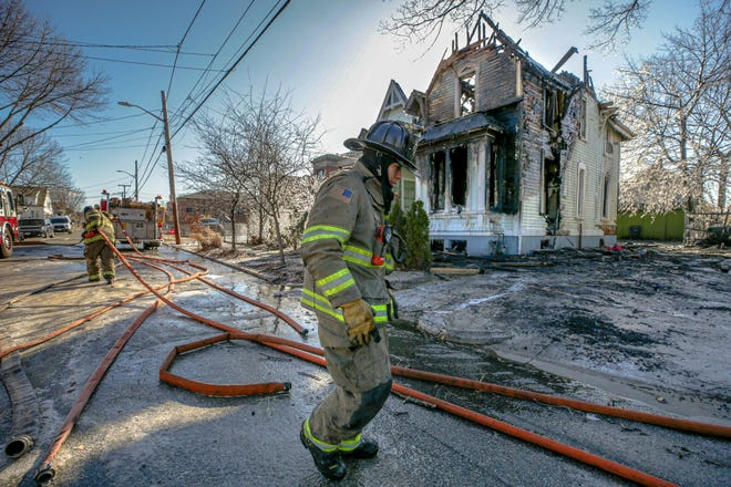 Firefighters battled a two-alarm fire at a home in the Elmwood neighborhood of Providence early Monday morning.