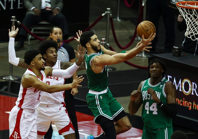 Boston Celtics forward Jayson Tatum scores a basket during the first quarter of an NBA basketball game in Houston on Sunday.