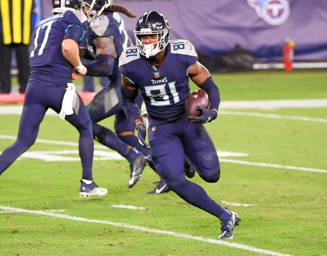 Nov 12, 2020; Nashville, Tennessee, USA;  Former Tennessee Titans tight end Jonnu Smith runs against the Indianapolis Colts during the first half of an NFL game on Nov. 12, 2020 at Nissan Stadium.