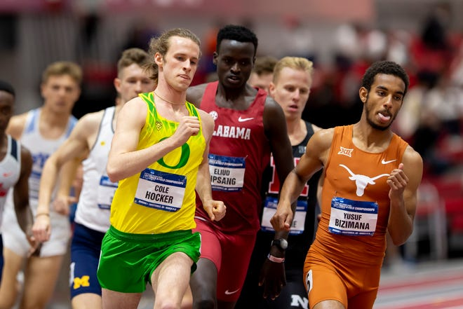 Cole Hocker (left) is the USTFCCCA national track athlete of the year after winning two individual events at the NCAA Indoor meet last weekend. (Photo by Andy Hancock/NCAA Photos via Getty Images)