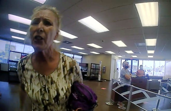 A frame grab from police bodycam video provided by the Galveston Police Department shows Terry Wright, 65, of Grants Pass, Ore., arguing with an officer inside a Bank of America branch Thursday in Galveston, Texas, after being told she needed to leave the bank because she was not wearing a face mask.