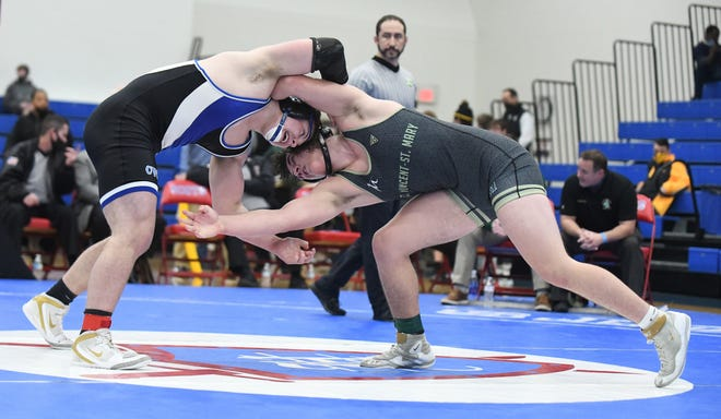 Kyle Snider of CVCA ,left, works on taking down Bryson Getz of St. Vincent St. Mary in their 220 pound state championship match.