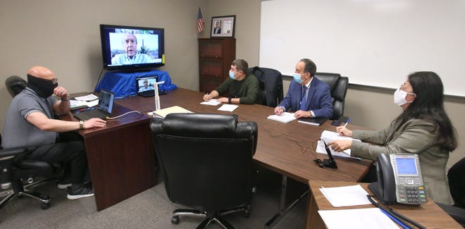 The Stark County Board of Elections met Monday to discuss legal options against county commissioners. From left are Tom Viscounte, Democratic IT specialist; William Cline (visible on monitor), board member, Kody Gonzalez, board member; Sam Ferruccio, board president; and Regine Johnson, department director.