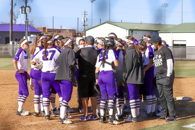 The Texans discuss strategy at Saturday's doubleheader at the Red & Charline McCombs Field in Austin. TSU dropped its first game to No. 10 Texas, 21-5, and its second game to BYU, 7-1.
