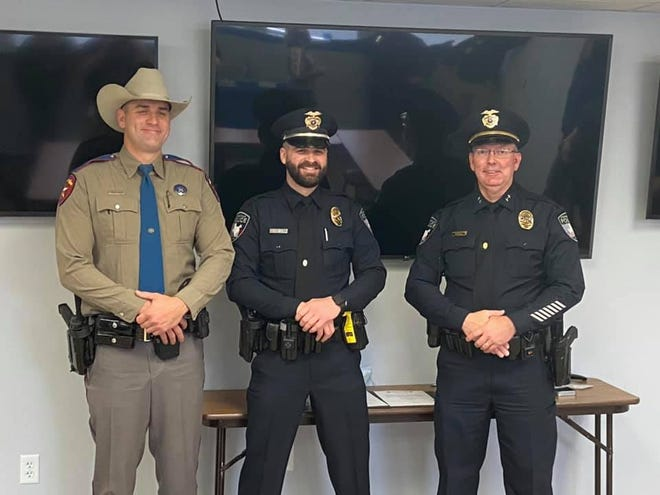 Stephenville Police's Lane Becker, center, was recently promoted to sergeant. His badge was pinned on by his older brother, Texas DPS Trooper Justin Becker, left, and he was sworn in by Chief Dan Harris.