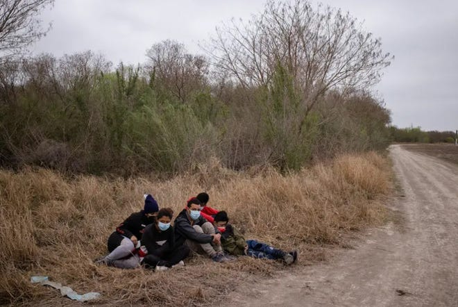Asylum-seeking unaccompanied minors from Central America are separated from other migrants by U.S. Border Patrol agents after crossing the Rio Grande river into the United States from Mexico on a raft in Penitas on Sunday.