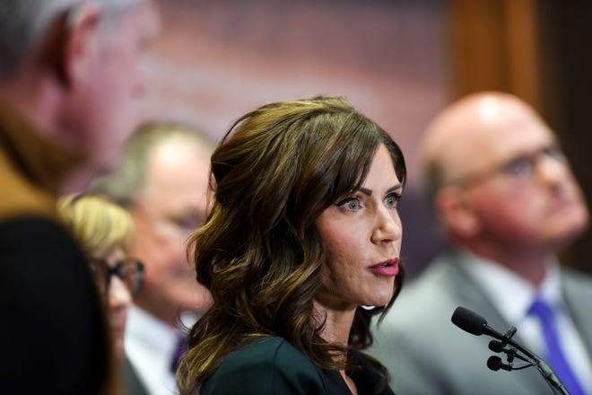 FILE - In this March 17, 2020, file photo, South Dakota Gov. Kristi Noem gives an update on the coronavirus in South Dakota, at the Sanford Center in Sioux Falls, S.D. Some of the nation's governors' offices routinely block access to public records to keep the public in the dark about key decisions involving the coronavirus pandemic. Noem's outspoken business-as-usual approach throughout the coronavirus pandemic has made her a darling of national conservatives and allowed her to hopscotch across the country as a fundraising force. (Abigail Dollins/The Argus Leader via AP, File)/The Argus Leader via AP)