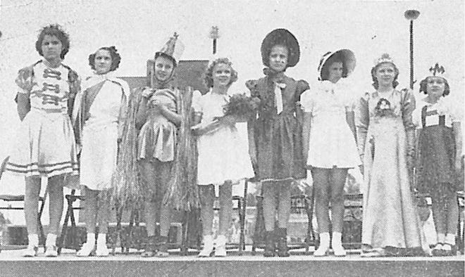 The 1940 Queens for the Little Olympics paused for a photo during the event. (l-r) Lillian Parks of Washington, Betty Darlene Wurth of St. Benedict's, Thomasine Allison of Woodrow Wilson,  Rita Harp of Horace Mann, Betty Bailey of Irving, Betty Sue Lee of Jefferson, Mary Lou Weir of Harrison, and Leona Hall of Franklin.