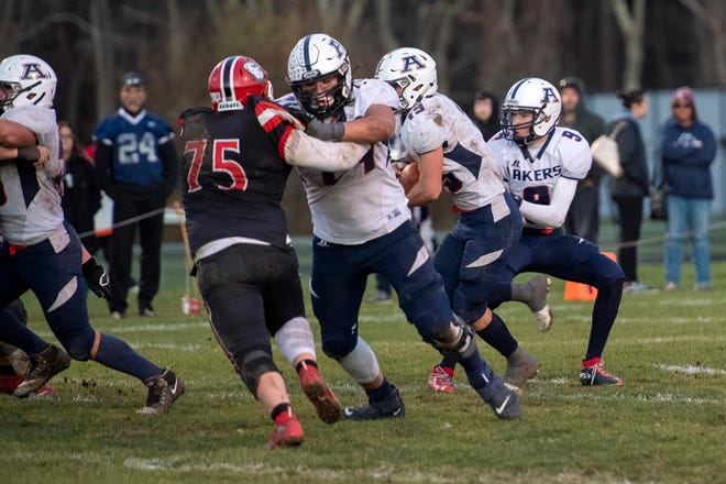 Apponequet's Brandon MacKinnon blocks Old Rochester's Brendan Stack during a game his senior year.  Coming off a prep year, MacKinnon, a 2020 Apponequet grad, has signed to play Div. I football at Northern Illinois University.