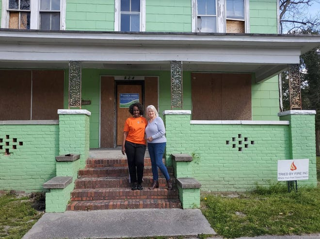 Bonita Burney Simmons, left, director and founder of Tried By Fire, Inc. stands with volunteer Deedra Deroucher at the future site of My Sister's House at 524 Roundtree Street in New Bern.