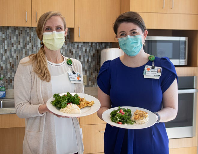 CarolinaEast dieticians Ashleigh Tyson and Ashley Bradshaw show off a meal of mashed cauliflower, chicken and kale-and-strawberry salad.