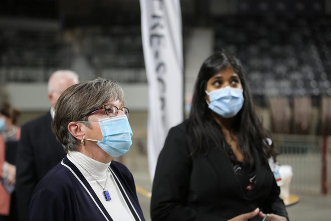 Gov. Laura Kelly, shown here touring a mass vaccination site in Topeka, is opening vaccine access to all Kansans ages 16 and older beginning March 29.