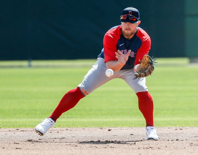 Red Sox second baseman Christian Arroyo takes fielding practice during a workout last month at spring training.