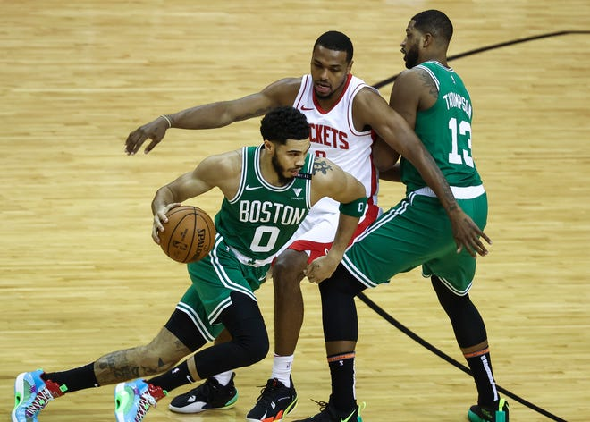 Celtics forward Jayson Tatum dribbles past Rockets guard Sterling Brown while the Celtics' Tristan Thompson sets the screen during the first quarter Sunday night in Houston.