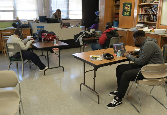 Students attend school in Monique Dowling's class in Burncoat High in Worcester on Monday.