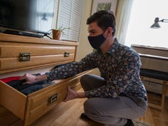 Chris Beers shows clothes folded in his dresser at his home in the Village of Florida,  Beers is a certified KonMari consultant.