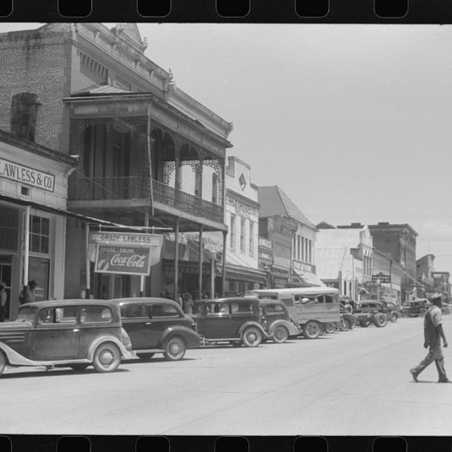 Greensboro, Alabama (date unknown): Those who know old cars can probably put an approximate date on this photo and those who remember old Greensboro can add other information to this photo. Reach Betty Slowe at bettyslowe6@gmail.com.