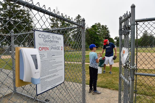 SIGN OF THE TIMES: A sign at the entrance gate to the field explains the COVID-19 park guidelines as athletes on the Danvers American Little League Angels team practice at Memorial Field on Monday, June 22, 2020. It should be a more normal schedule for Little Leaguers this spring and summer.
