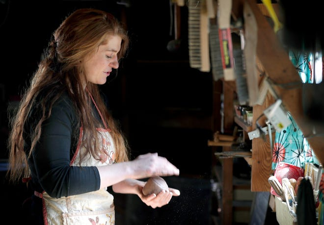 Madisen Potratz works in her Good Art for Good studio March 12 in Oshkosh. Good Art for Good donates a portion of every sale to nonprofit organizations based in Wisconsin.