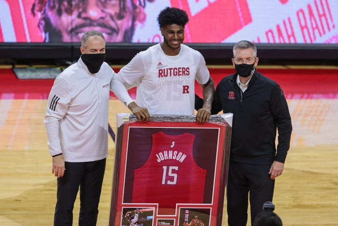 Rutgers Scarlet Knights center Myles Johnson (15) poses for a photo with head coach Steve Pikiell, left, and athletic director Patrick Hobbs