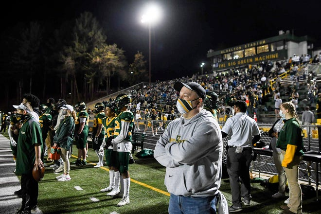 Scott Tweed takes in Reynolds football's home-opener against Roberson on March 12, 2021.