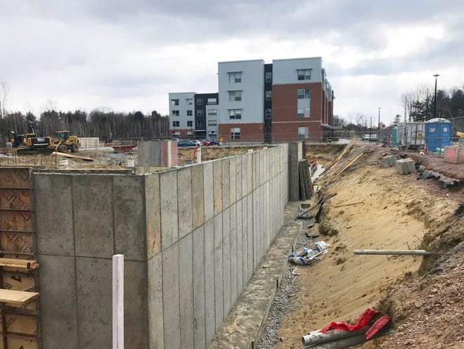 A foundation rises at Dover Place, a 43-unit apartment building in South Burlington's City Center on March 14, 2021. Directly south is Garden Street Apartments, a 60-unit building completed in late 2019.