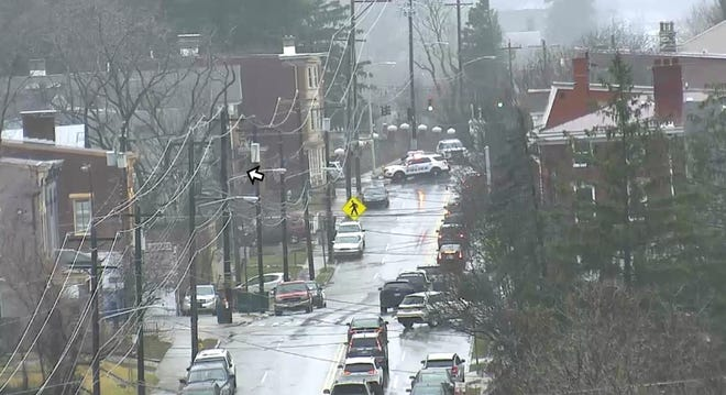 Cincinnati police closed a section of West Eighth Street at Enright Avenue Monday in East Price Hill after four vehicles crashed.