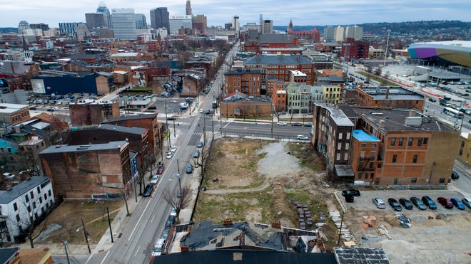 A view of the northwest corner of West Liberty and Elm streets in Over-The-Rhine on Monday, March 15, 2021. Updated plans for the property are before Cincinnati City Council and call for more than 3 acres of development including 15,000 square feet of commercial space and nearly 300 market rate apartments.