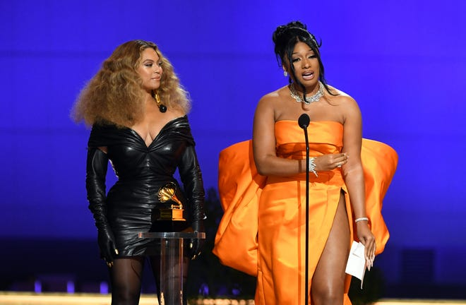 "Beyoncé and Megan Thee Stallion accept the best rap performance award for ""Savage"" during the Grammy Awards at the Los Angeles Convention Center on March 14, 2021."