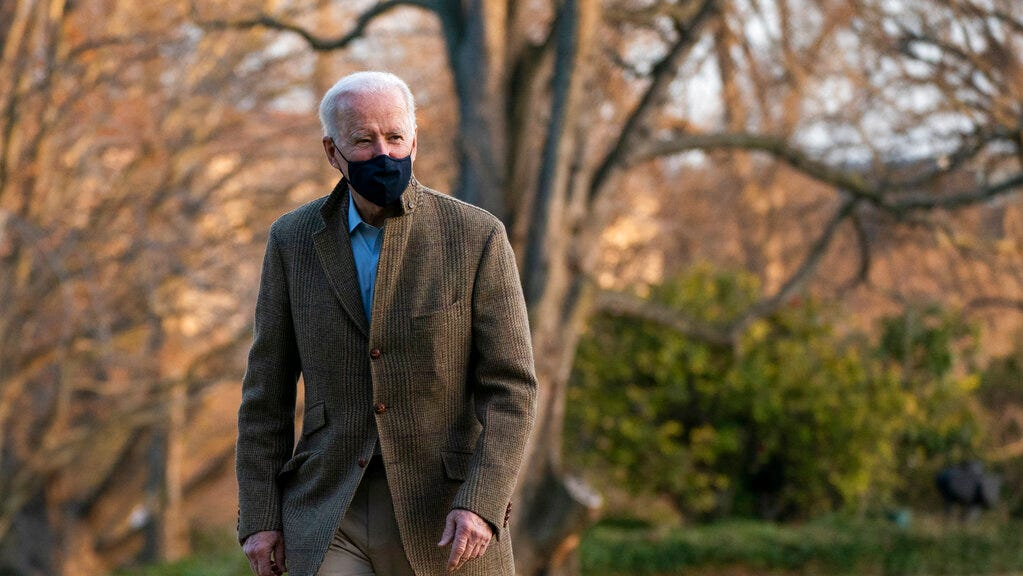 President Joe Biden walks on the South Lawn upon arrival at the White House in Washington from a weekend trip to Wilmington, Del., Sunday, March 14, 2021.