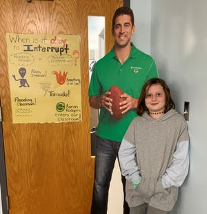 Avery Woods, a fifth-grader at Merton Intermediate School in Merton, showed up one morning with an Aaron Rodgers cardboard cutout. She was inspired by a sign that has been hanging in teacher Becky Frei's classroom for the last five years.