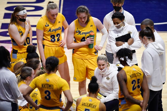 Head coach Megan Duffy will lead Marquette in the NCAA women's basketball tournament. The event was canceled last season, Duffy's first with the Golden Eagles.