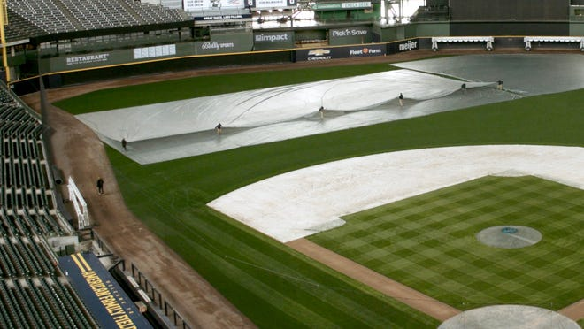 A sure sign of spring happened Monday when the Milwaukee Brewers grounds crew removed the tarp from American Family Field for the 2021 season.