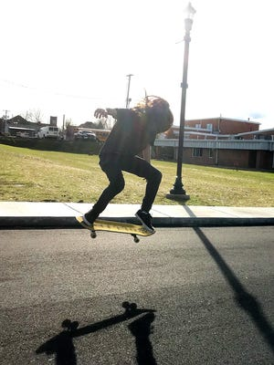 Noah Cooper skates in front of the future site of the City of Dickson skate park in Downtown Dickson.
