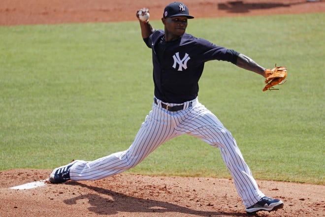 Mar 15, 2021; Tampa, Florida, USA; New York Yankees starting pitcher Domingo German (55) throws a pitch during the first inning against the Philadelphia Phillies  at George M. Steinbrenner Field. Mandatory Credit: Kim Klement-USA TODAY Sports