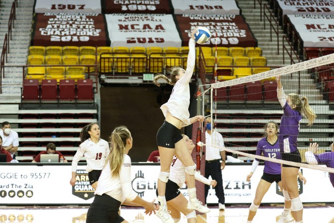 Redshirt junior Lia Mosher elevates for a kill during New Mexico State's game against Tarleton State on Monday, March 15, 2021, at the Pan American Center in Las Cruces, New Mexico.