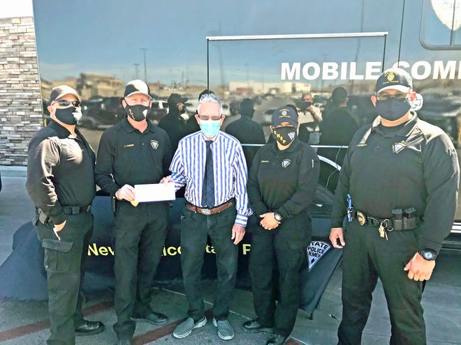 The Las Cruces Rotary Club donated funds to the New Mexico State Police Association Friday for the benefit of the family of fallen State Police Officer Darian Jarrott.