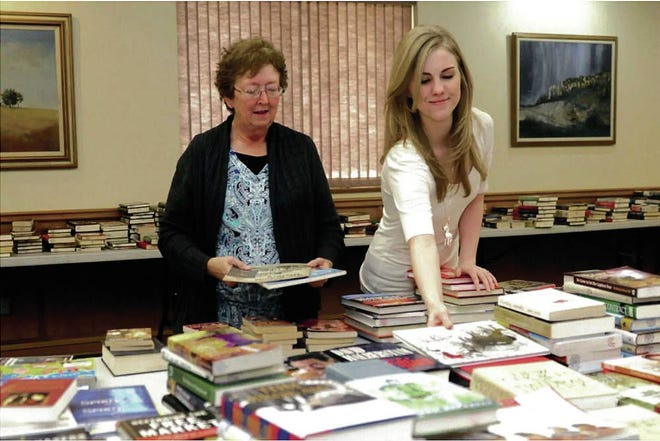 Wanda Walters left, and Jessica Thron right, working at the Clovis Carver Library. Walters was murdered during a mass shooting at the library on Aug. 28, 2017, and Thron was injured in the incident.