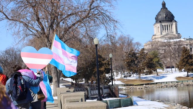 Transgender rights advocates protest at Gov. Kristi Noem's mansion and at the Capitol in Pierre, South Dakota on Thursday, March 11, 2021.