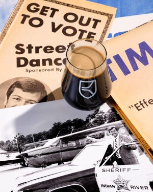 In promotional materials for Sheriff Dobeck, an 11% imperial stout, Waukee, Iowa-based Kinship Brewing Co.'s Zach Dobeck used memorabilia from his father's political campaigns. In 1980, Tim Dobeck was elected sheriff in Indian River County, where he retired after moving to Georgia in the early 1990s.