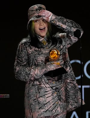 "Billie Eilish reacts as she accepts the award for record of the year for ""Everything I Wanted"" at the 63rd annual Grammy Awards."