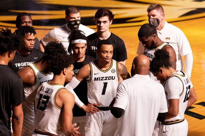 Missouri players gather around coach Cuonzo Martin before the start of an NCAA college basketball game against LSU on March 6 in Columbia.