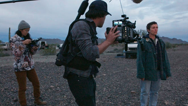 "Chloé Zhao, left, director of photography Joshua James Richards and actress Frances McDormand on the set of ""Nomadland."""