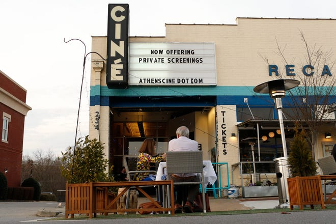 Ciné, which is now open for private screenings, and neighboring restaurant The National's parklet in downtown Athens, Ga., on Friday, March 12, 2021.