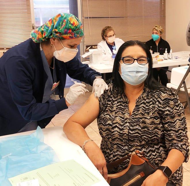 San Diego ISD teacher, Isabel Benavides, received her first dose of Pfizer by Alicia Tobar, RN at Christus Spohn Alice.