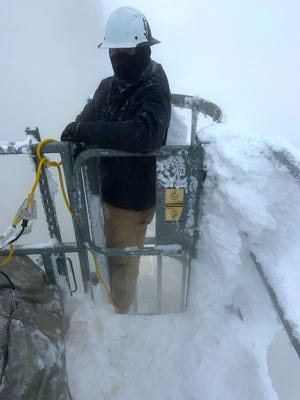 Xcel Energy employee Mike Harz is shown working in harsh weather conditions during a recent snow storm. The company announced that it is dedicating a week to celebrating its essential frontline workers.