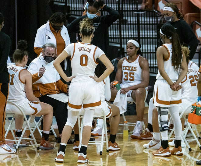 Texas head coach Vic Schaefer,far left, draws up a play during a game against TCU in January. The Longhorns will play Bradley in the first round of the NCAA Tournament.