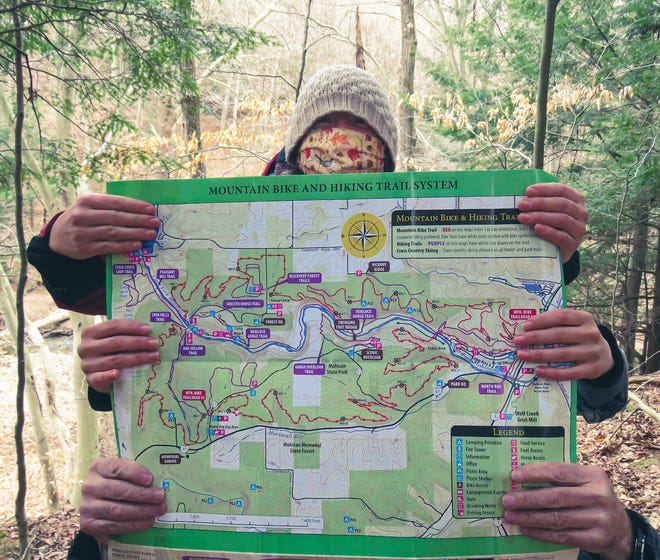 The new Mohican Regional Trails Guide sure comes in handy — no matter how many hands you have.