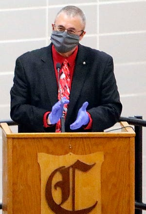 """Superintendent Randy Dunlap applauds as James Stuart poses on stage with his diploma during Crestview High School's virtual graduation ceremony last May. Dunlap's resignation was formally accepted by the Board of Education March 15. """"Even during this most trying time in my 33-year career, our focus was always on how we could best serve our students ...,"""" he said in his resignation letter."""